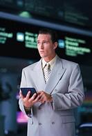 portrait of a stock broker holding a calculator