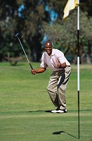 Golfer elated after making a shot