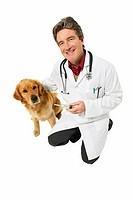 Portrait of a vet with a golden retriever