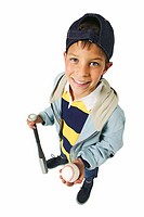 elevated view of a boy (11-12) holding a baseball bat and baseball