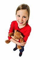 Elevated view of a girl ( 11-12) holding teddy bear