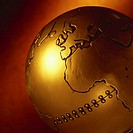close-up of the side of a brass globe riveted at the center