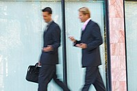 businessmen walking and talking