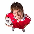 Elevated view of a smiling man holding a soccer ball