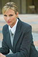 portrait of a businesswoman sitting on steps