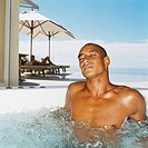 portrait of a young man relaxing in a hot tub
