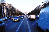 view of traffic moving on the street of the arc de triomphe in Paris