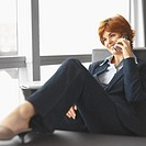 Close-up of businesswoman talking on mobile phone