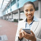 Close-up front view of businesswoman holding pda