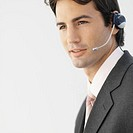 Close-up of businessman wearing headset