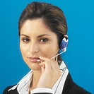 Front view portrait of businesswoman wearing headset
