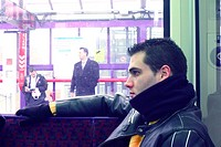 Young man  sitting on a train