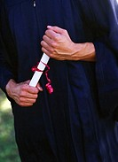 close-up of hands holding a graduation degree