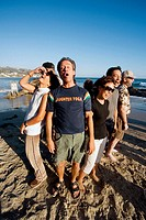Members of a 'Laughter Yoga Club' meet by the seaside in Laguna Beach, CA.  Believing that 'laughter is the best medicine,' they engage in laughter fo...