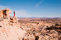 Grand Staircase National Monument, Utah. A woman looks out at the view of the geologic layers of rock.