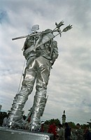 A silver statue of an explorer
