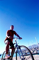 Low angle view of a mid adult man cycling
