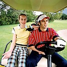 Young couple in a golf cart