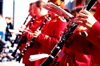 Side profile of young boys and girls (10-14) playing the clarinet in a choir
