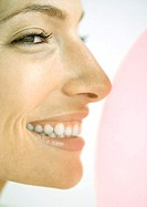 Woman smiling, close-up profile of face