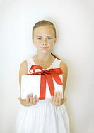 Girl holding present, front view