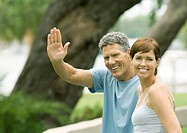 Mature couple, man waving