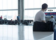 Man waiting near departure gate