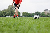 Footballer approaching football