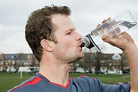 Footballer drinking water