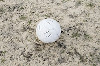 Football on sandy ground