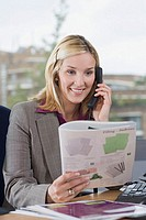 Smiling businesswoman holding a brochure