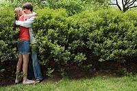 Teenage couple kissing in bush