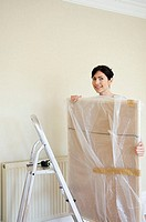 Woman holding a wrapped picture (thumbnail)