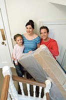 Family on stairs with mattress