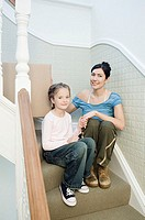 Mother and daughter on stairs