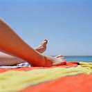 Legs of woman sunbathing (thumbnail)
