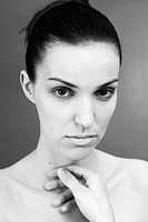 Young woman with a sad face, black and white photo