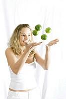 A girl playing with lemons