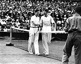 Tennis players Donald Budge and Von Cramm shaking hands following a match at Wimbledon, 3 July 1935.