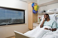 Patient on telephone in hospital bed
