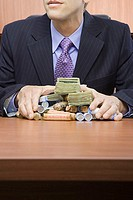 Businessman holding stack of money