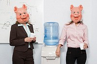 Two businesswoman in pig masks at a water cooler