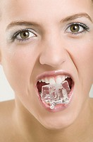 Woman with an ice cube in her mouth