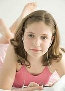 Preteen girl listening to earphones