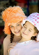 Two girls wearing funny hats, portrait