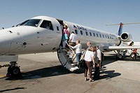 Delta, commuter jet, passengers boarding. Orlando Airport. Florida. USA.