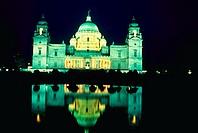 Victoria Memorial at night in Calcutta being reflected in the pool - Calcutta, India.