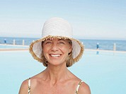 Mature woman wearing sun hat, smiling, portrait, close-up