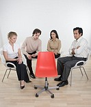 Business Team Staring at Empty Chair