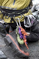 Climber with ropes and carabiners on belt, close-up